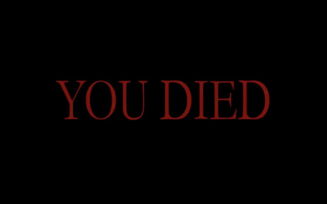 """Red, serif text on a black background reads, """"YOU DIED."""""""