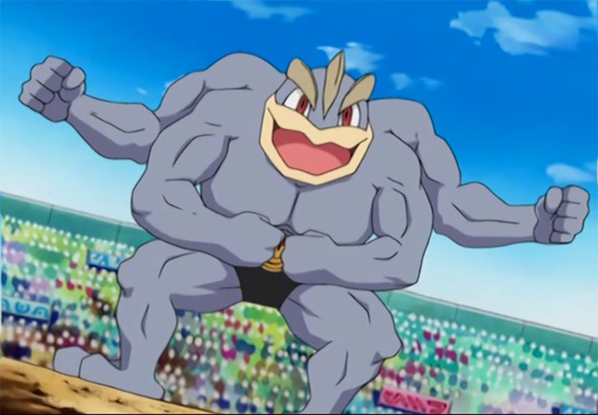 A shot of Machamp, the body building pokemon. He's gray, he's got four arms, and he's got a BIG smile.