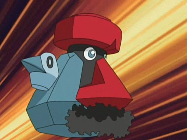 A shot of Propobass, a pokemon with a blue body and a bright red nose that goes the length of said body. It also has a bushy 'stache.