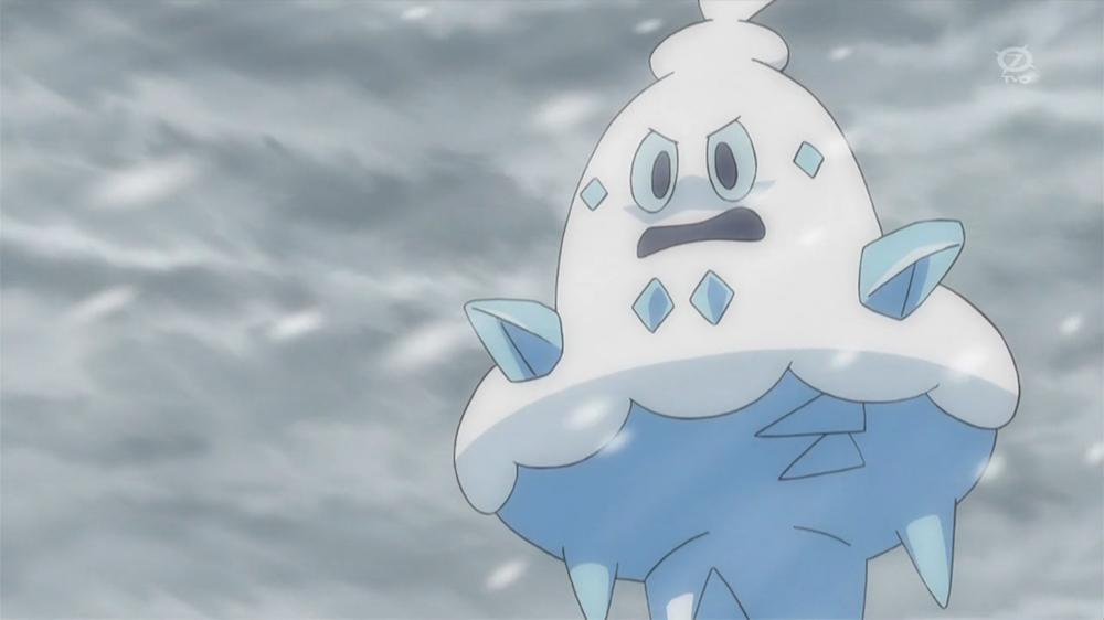 A shot of Vanillish, a pokémon shaped like an ice cream cone, against a stormy gray sky.