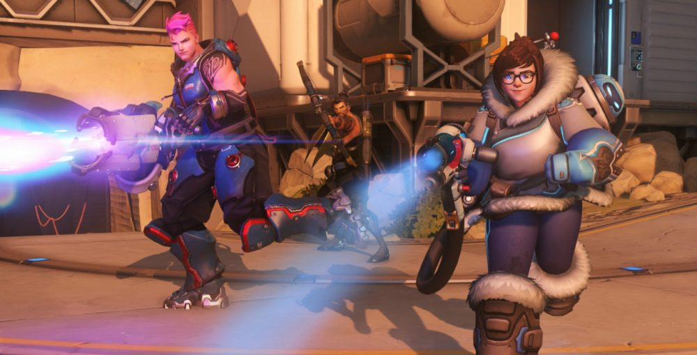 Zarya and Mei run through the frame, each shooting their respective guns. Overwatch, Blizzard Entertainment, 2016.