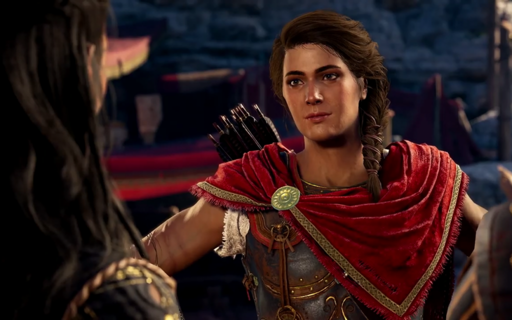 Kassandra faces the camera, gazing at the woman she's talking to. Assassins Creed Odyssey, Ubisoft, 2018