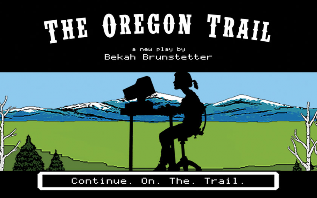 The Oregon Trail promo image. A young girl sits in front of a computer at a desk. Behind her is a landscape featuring mountains. Fault Line Theater, 2017.
