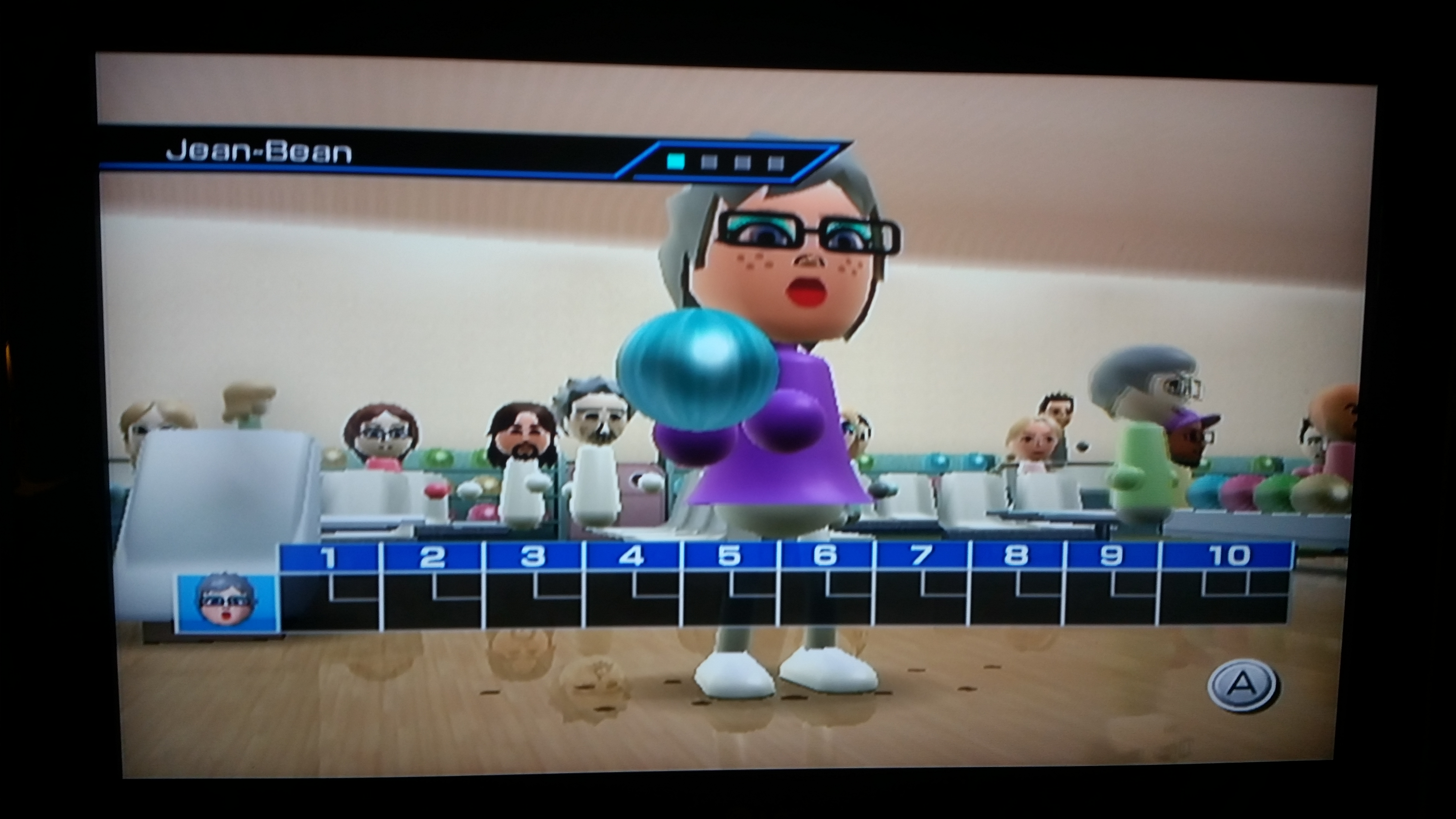Screenshot of Jean's Mii ready to bowl, with various Miis in the background. Wii Bowling, BANDAI NAMCO, Nintendo, 2006.