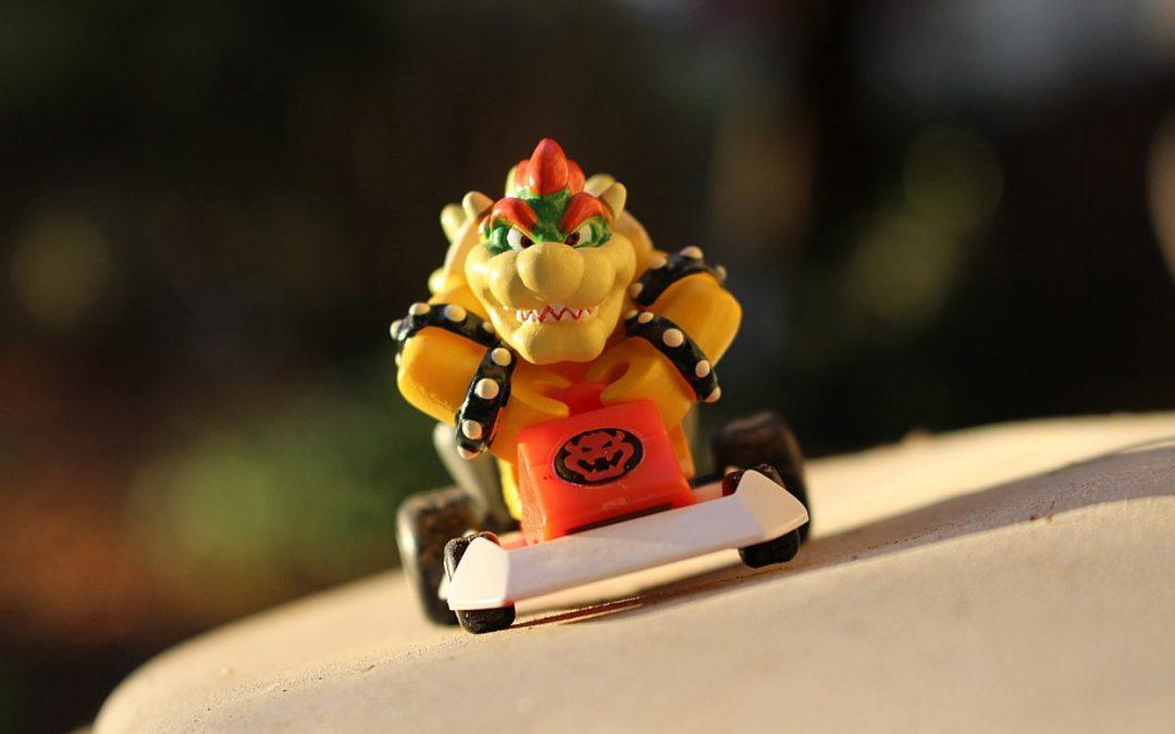 A photo of a Mario Kart Bowser driving toward the camera.