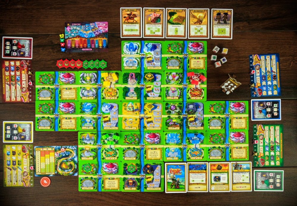 A photo of Tiny Epic Quest, with all the pieces and cards spread out.