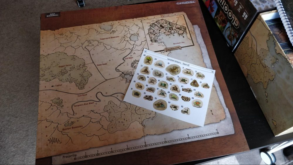 A photo showing Gloomhaven's map and place stickers.