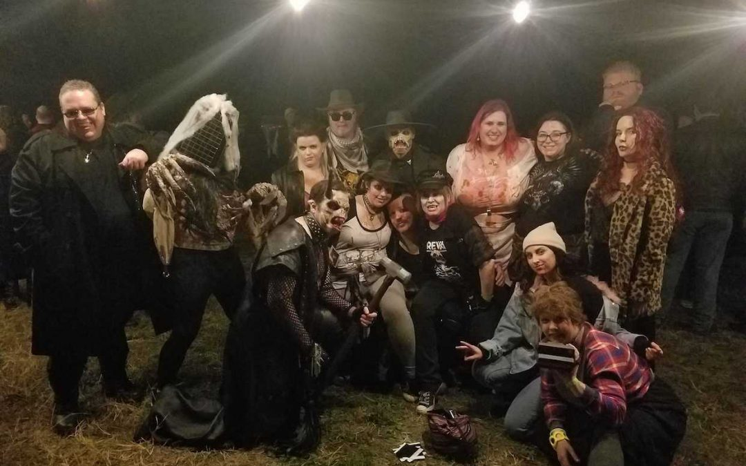A photo of several people in demonic costumes.