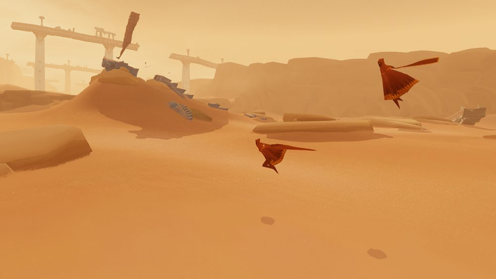 An open desert, with two figures in red robes jumping through it. Journey, thatgamecompany, Sony Computer Entertainment, 2012.