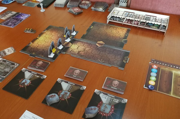 Enemy cards, tiles and enemy figures are laid out. To the left is the Elements board with the element tokens on it.