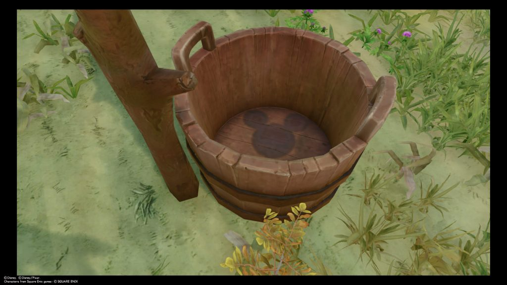A picture of a Lucky Emblem stain at the bottom of a bucket in 100 Acre Woods. Kingdom Hearts III, Square Enix, 2019.