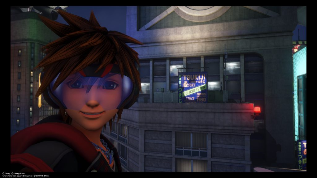 Sora takes a selfie in front of a building in San Fransokyo at night where a Lucky Emblem-shaped light is being cast. Kingdom Hearts III, Square Enix, 2019.