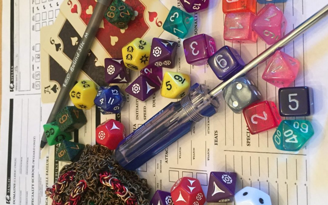 A photo of a character sheet with dice, pencils, and a screwdriver strewn on top of it. Photo by author.