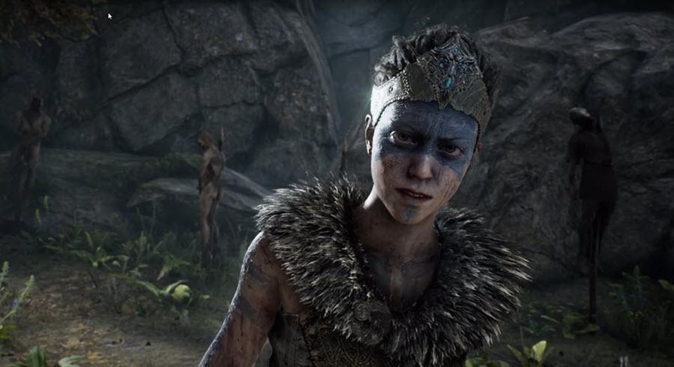 A screenshot of Hellblade: Senua's Sacrifice showing Senua looking into the camera. Hellblade: Senua's Sacrifice, Ninja Theory, 2017.