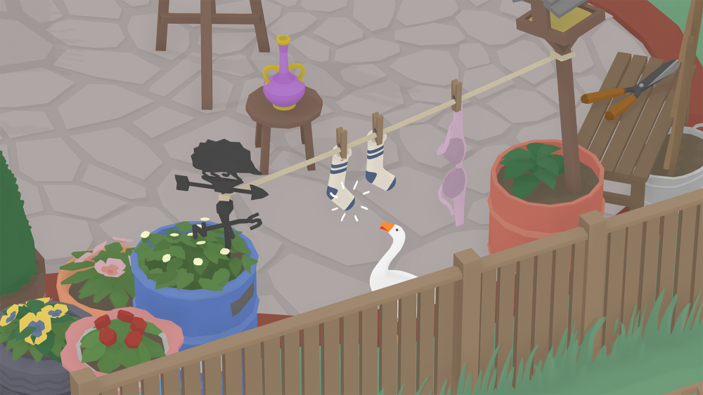 A screenshot of the Untitled Goose Game showing the Goose considering snatching a sock from a clothesline.