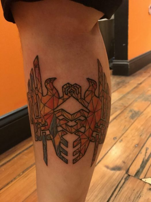 A tattoo of the Amell symbol in a stained-glass pattern