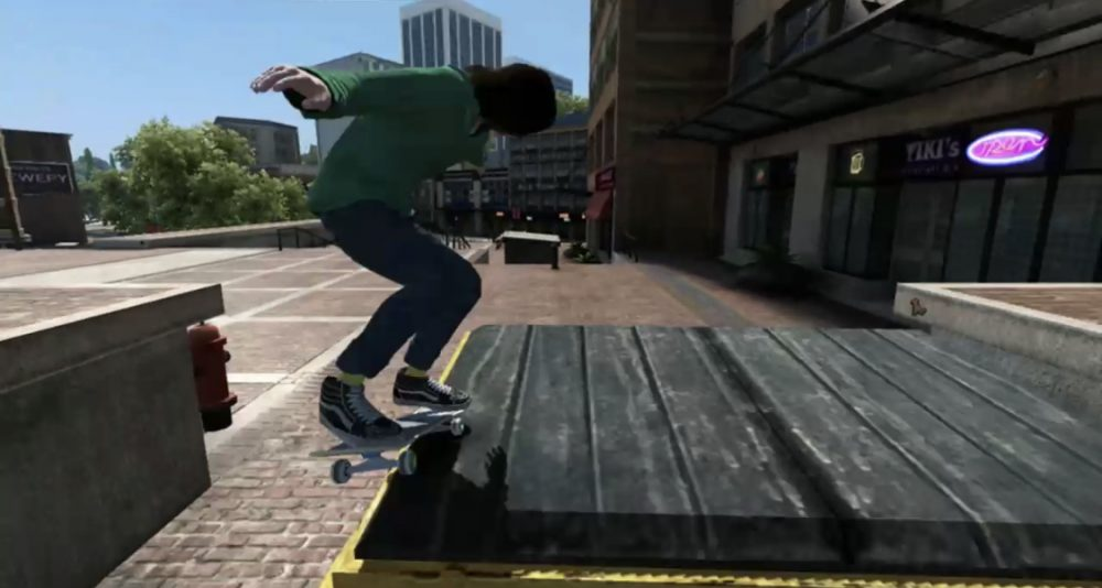 A skater in a green hoodie and jeans grinds on a dumpster outside a bougie strip mall. Skate 3, EA Black Box, EA, 2010.