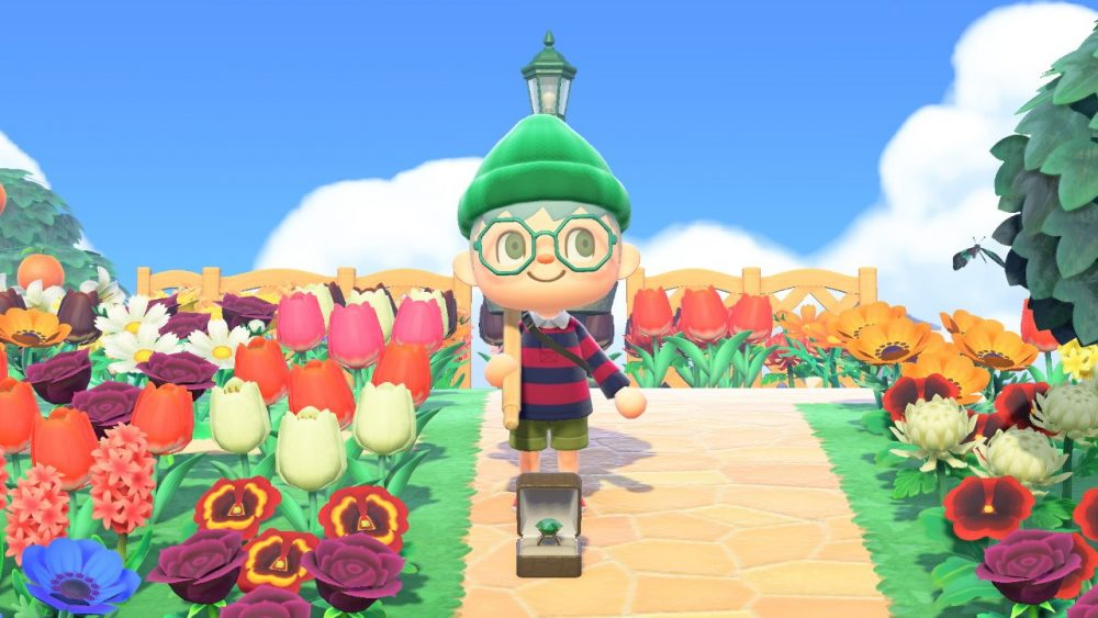 Pipis, wearing a green beanie, a red and navy striped shirt, and octagonal hipster glasses, stands in front of an engagement ring surrounded by flowers. Animal Crossing: New Horizons, Nintendo, 2020.