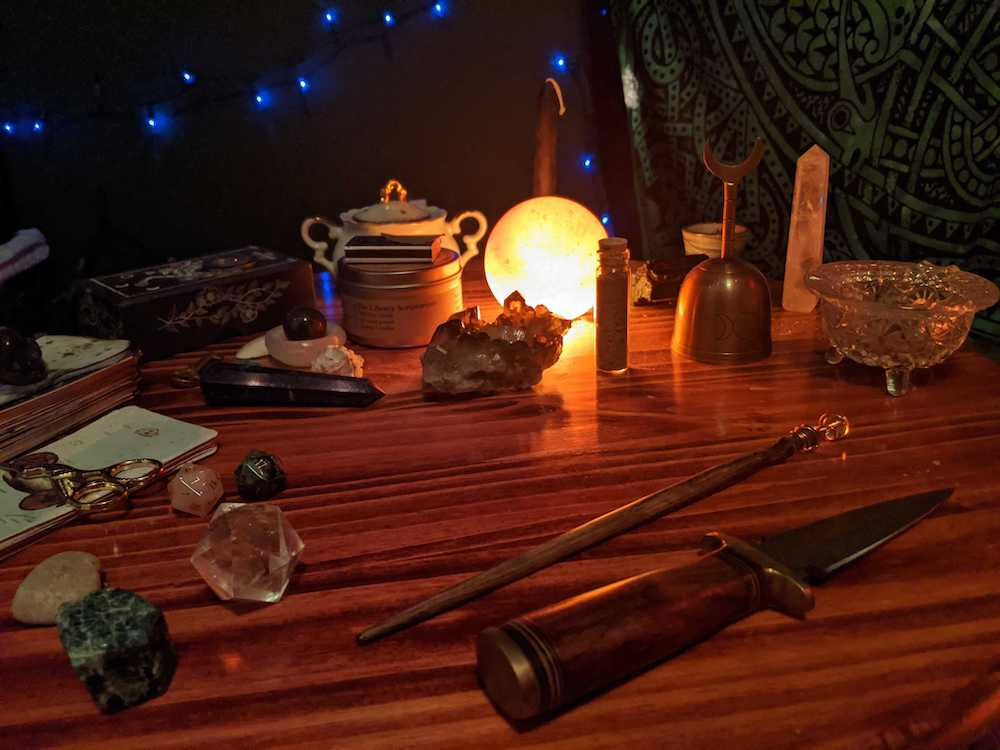 A tea table covered in magical paraphernalia