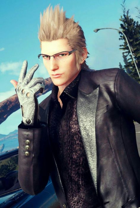 Ignis, a broad-shouldered light-skinned man with spiked gray hair, gestures at the camera. He's wearing a mottled light gray driving glove and what appears to be a black leather blazer over a dark leopard print shirt. His glasses are thin, with slim dark rims over the lenses. (Final Fantasy XV)