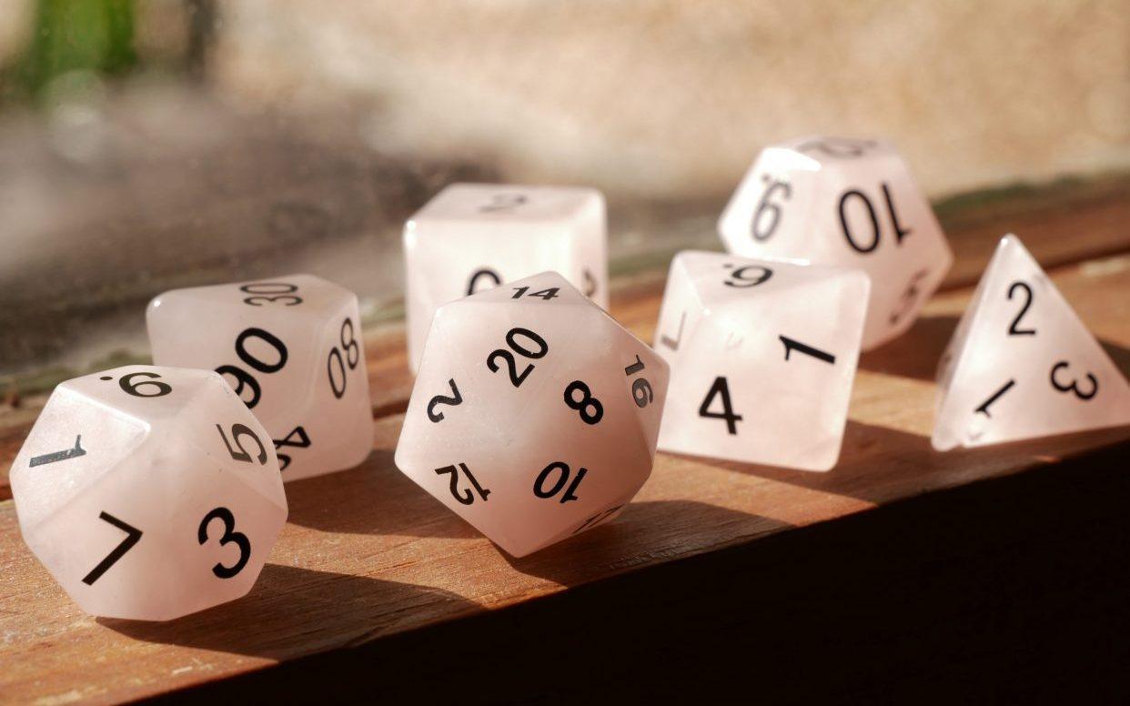 A photo of dice on a windowsill.