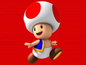 An image of Toad from the Mario franchise, looking over their shoulder. Toad wears a white hat (?) with red dots, a blue-and-gold jacket, and white pants.