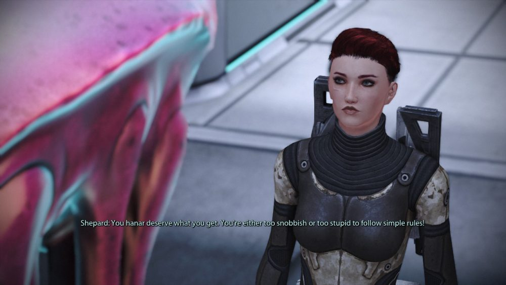 """An screenshot from Mass Effect 1. Commander Shepard addresses a jellyfish like alien, saying, """"You Hanar deserve what you get. You're either too snobbish or too stupid to follow simple rules!"""""""