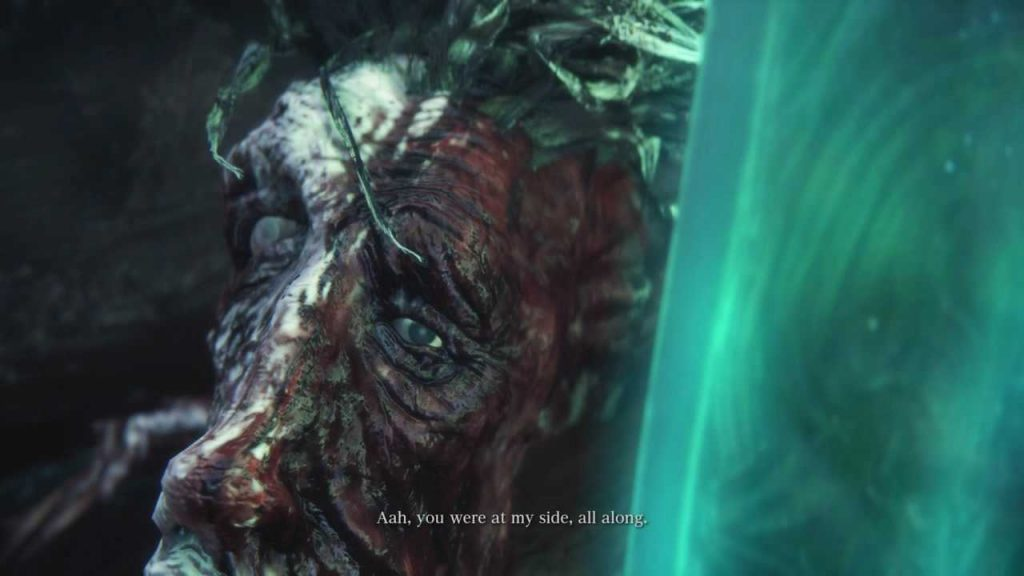 """Zoom-up on the bloody face of Ludwig, one eye open while the other is swollen shut, saying, """"Aah, you were at my side, all along."""" Platinum Trophy unlocked. The hunter stands in a lit room, part of a dungeon, over a wrapped body. Bloodborne, FromSoftware, Sony Entertainment, 2015."""