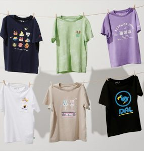 T-shirts hang from two rows of clotheslines. The shirts sport various Animal Crossing-related designs.