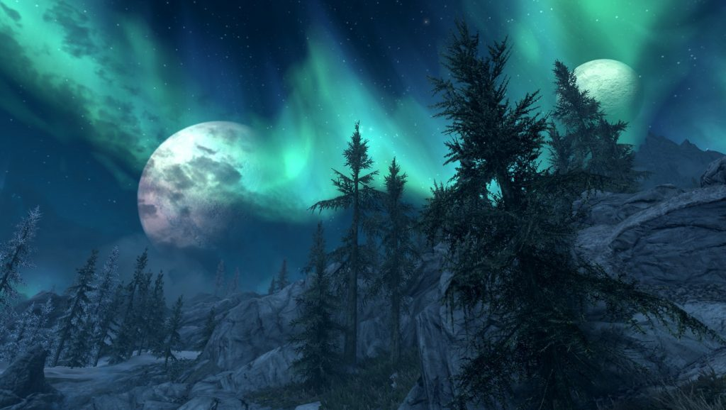 The aurora borealis shines in green behind a pocked moon, fir trees, and mountains. The Elder Scrolls V: Skyrim, Bethesda, 2011.